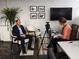 Aletta Harrison interviewing Ian Merrington as part of a television segment for TRT World.