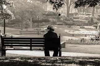 woman-sitting-alone-on-a-bench.jpg