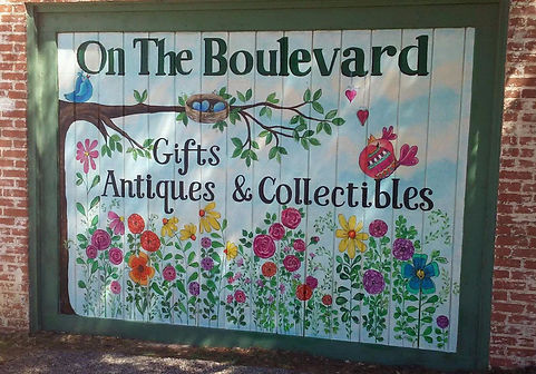 gifts, antiques, collectibles, carved sculpture, donna dewberry, handmade soaps, mosaic furniture, paracord bracelets, energy gardens, wreaths