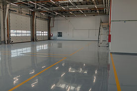 Epoxy-and-waxed-flooring-with-colorful-signage-in-car-service-1269936567_1258x838 (1).jpeg