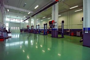 An-empty-repairs-garage-with-green-floor-460638261_1254x839 (2).jpeg