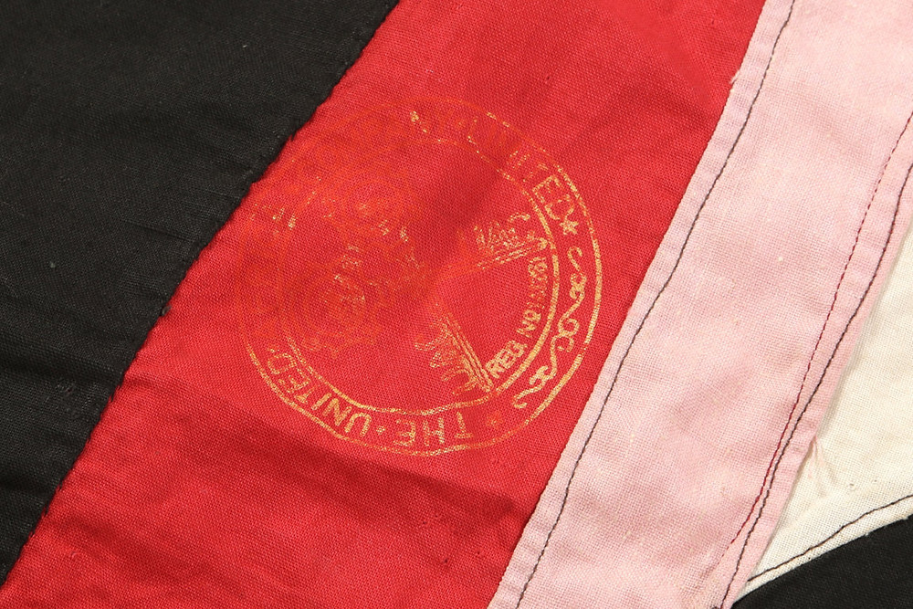 "This flag has an unusual stamp of ""The United Africa Company""  The United Africa Company was a British company which principally traded in West Africa during the 20th century. The United Africa Company was formed in 1929 as a result of the merger of The Niger Company, which had been effectively owned by Lever Brothers since 1920, and the African & Eastern Trade Corporation."