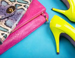 Neon high heels, dress and snakeskin print bag, woman fashion concept