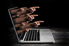Cyber bulling concept with fingers from