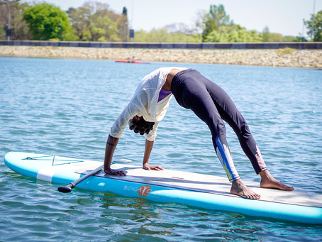 Top tips to sail through your first SUP Yoga class
