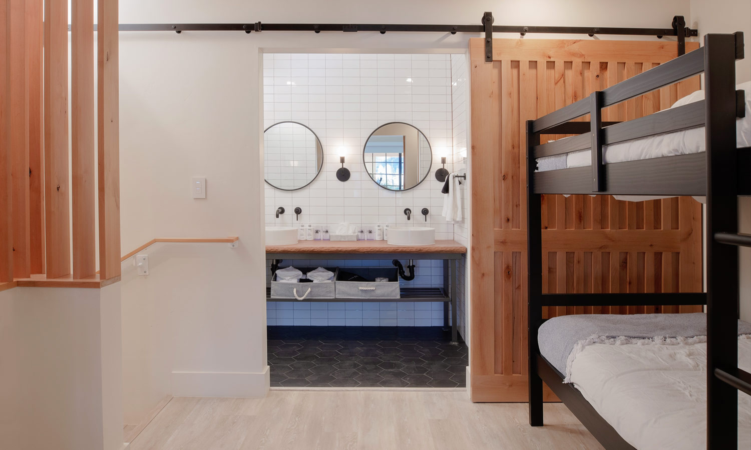 Two Floor Suite: Bath with dual sink; twin beds at top of landing