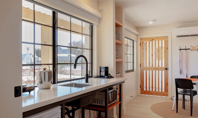 King Suite: Kitchenette with view to entry door with secure pet door