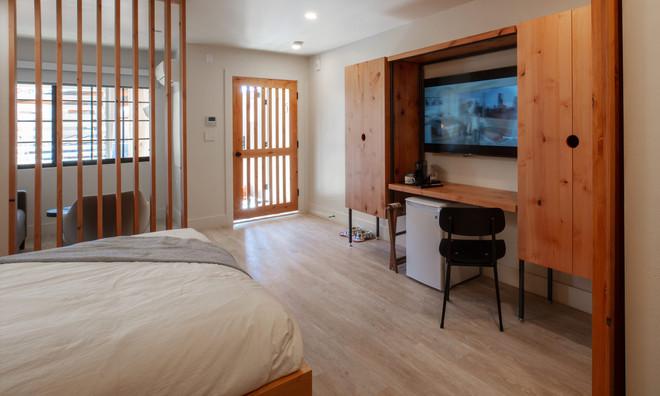 Standard Room: TV, mini fridge, armoir, work desk
