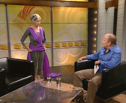 Ruthy jumps in wrap on TV.png