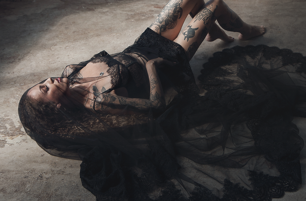 Moody bridal boudoir with black lace veil and lingerie, tattoed bride