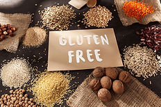 Various gluten free grains and cereals with handful of walnuts
