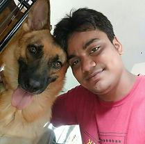 Doggiliciouus' kitchen supervisor, Birendra Nath Das, sitting next to Kira as they look into the camera