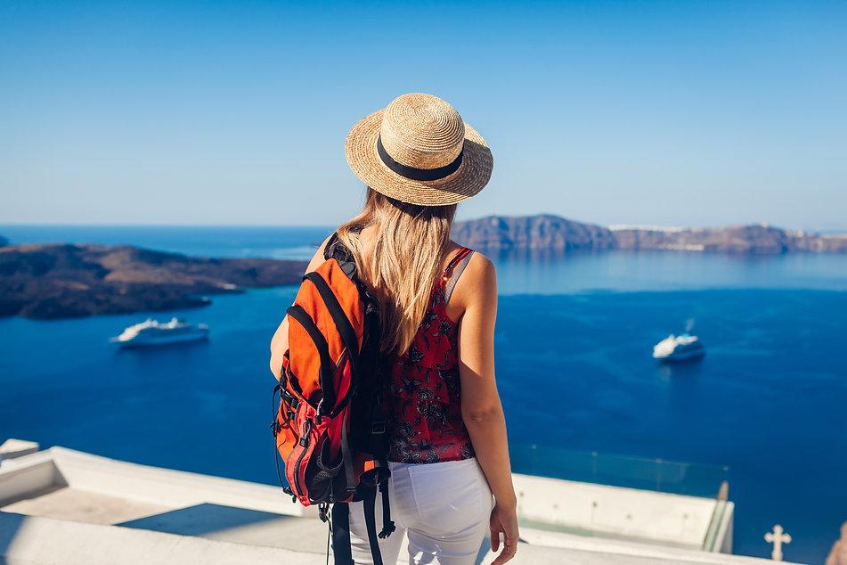woman-traveler-looking-caldera-from-fira-thera-santorini-island-greece-tourism-traveling-v