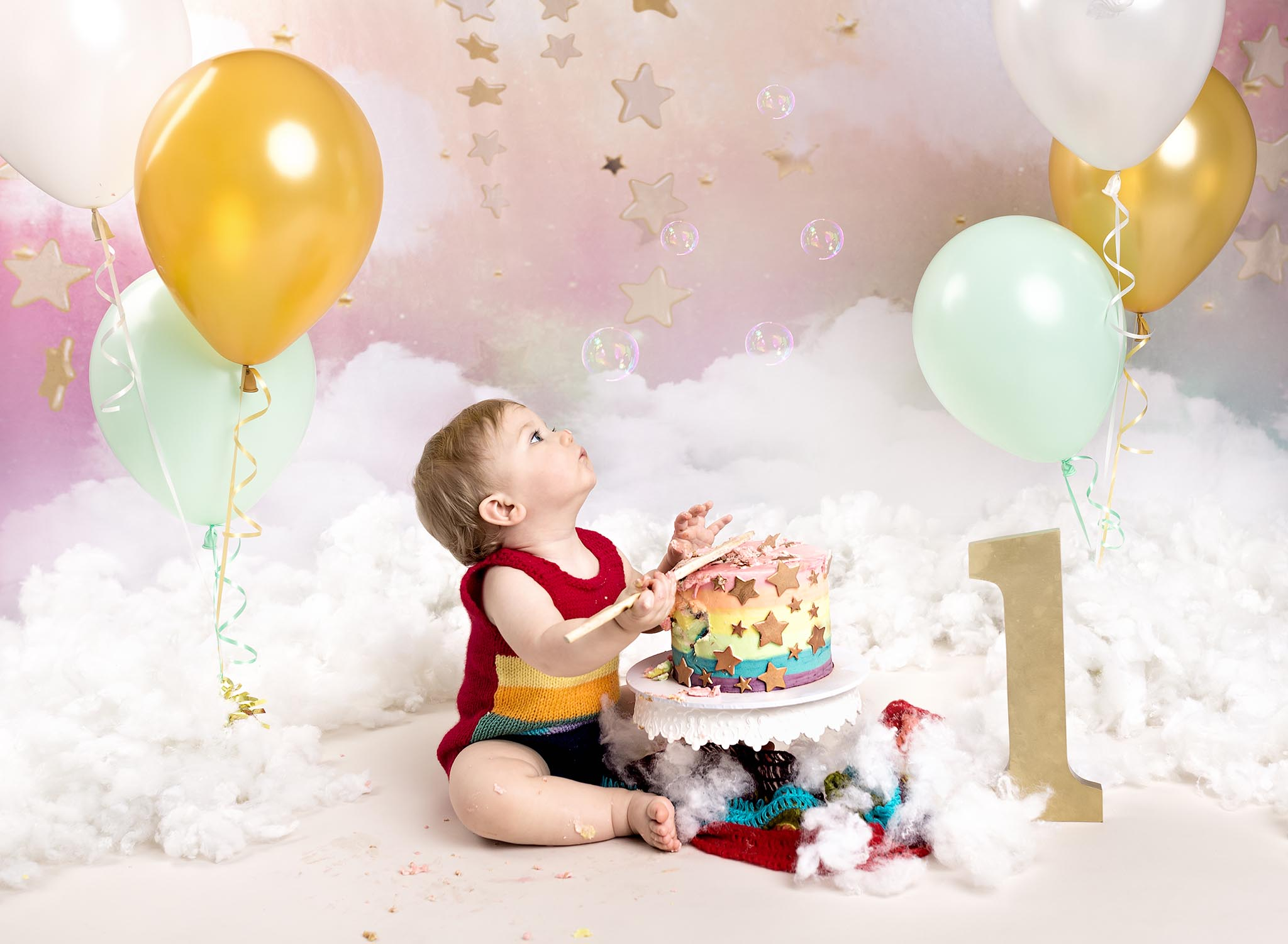 Rainbow themed 1st Birthday cake smash photography