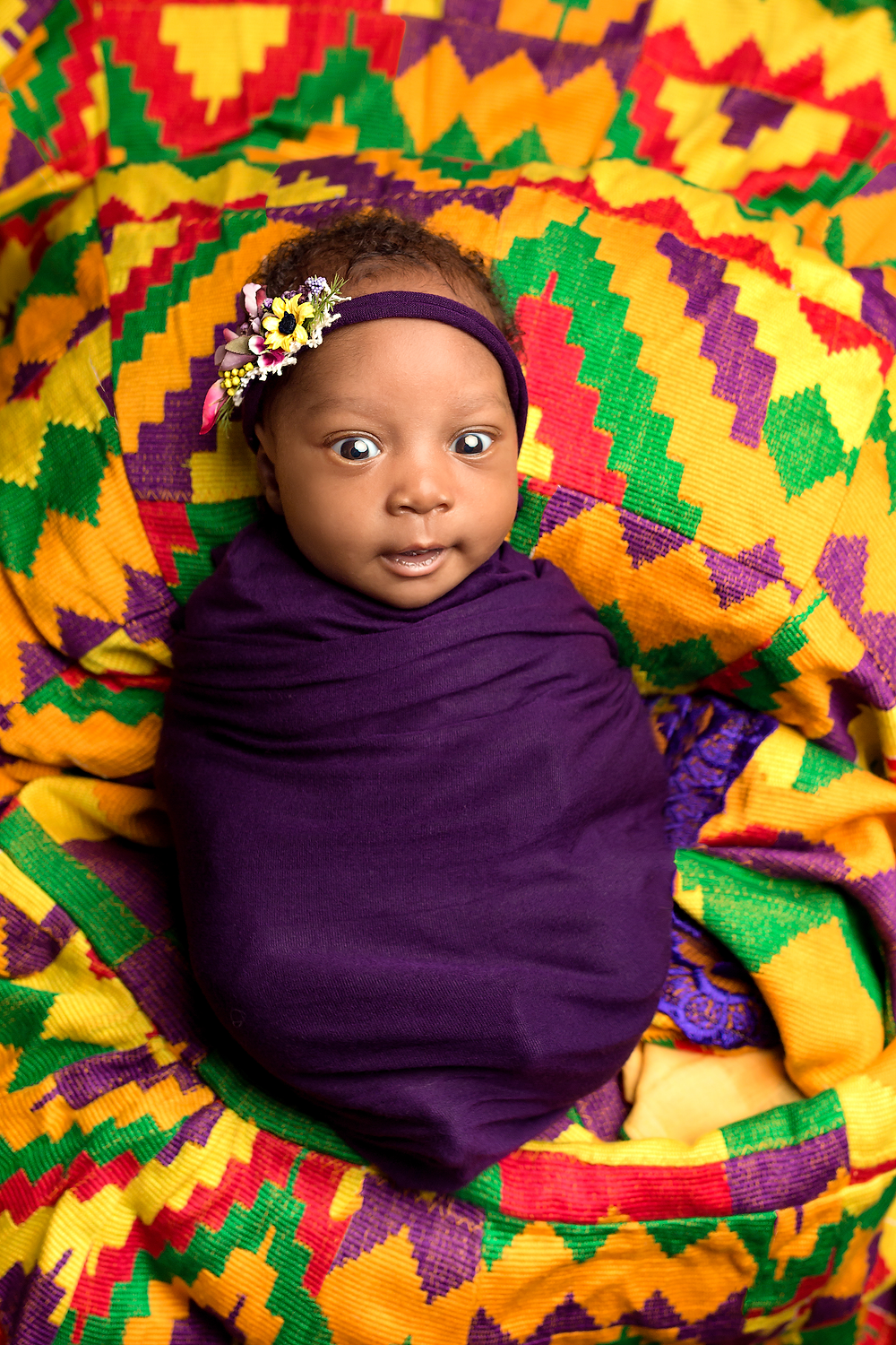Wrapped baby on Ghanan national dress