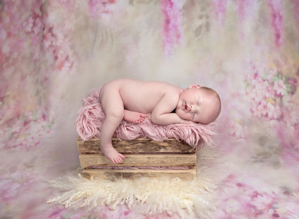 Baby posed on a prop