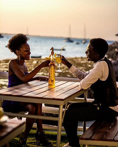 Two people enjoying Giraffe Gin cocktails.