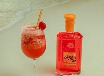 Red Hakuna Matata gin with a cocktail on the beach.