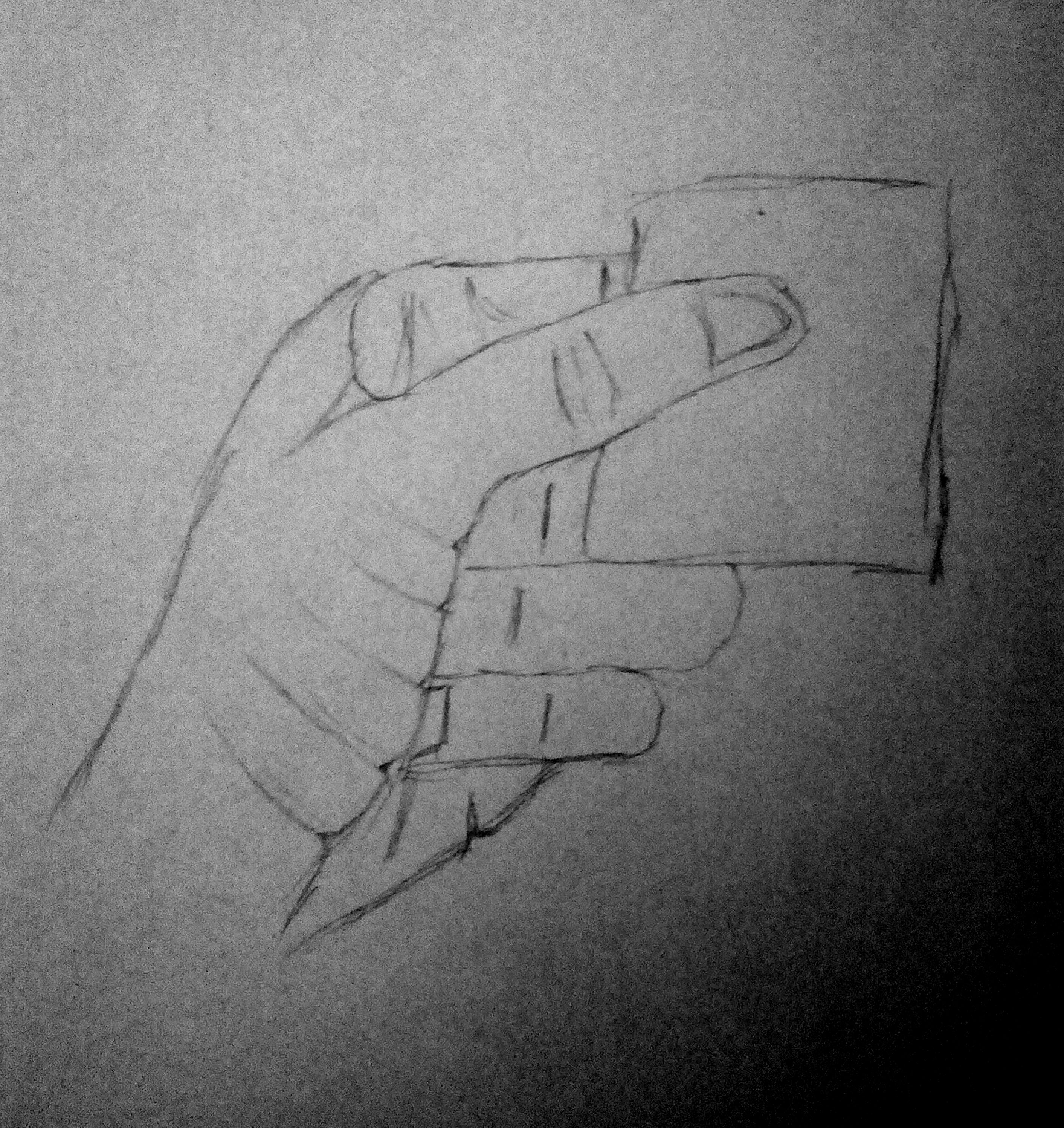 Hand Holding Folded Paper.jpg