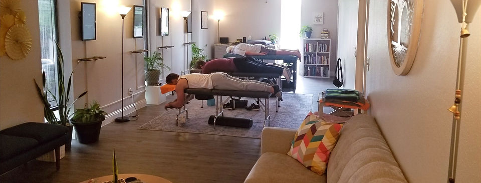 Practice members at Evolve Chiropractic receiving care in our warm, welcoming community care room.