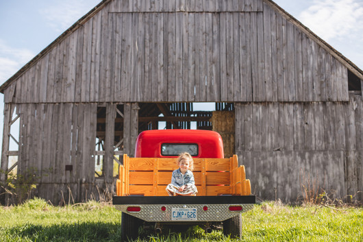 little girl in the Red Dog Rig