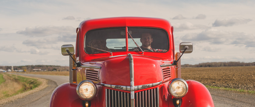 man and dog in vintage truck