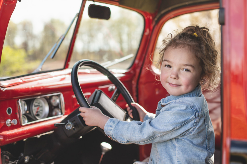 cute girl behind the wheel