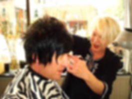 Adrienne cutting Seth's hair from Project Runway