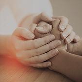 Transitional Care Mangement patients holding hands