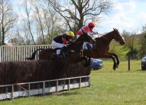Finlay's Eyes (far side) outjumps Rose Iland (yellow cap) on the first circuit