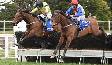Ruby (left) wins the Australian National on Bashboy in 2015
