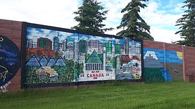 A mural of various Edmonton landmarks painted on a fence in West Edmonton.