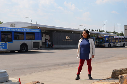 Giselle standing in front of the West Edmonton Mall transit centre.