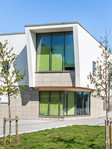 white rendered modern school overhang exterior architectural photography