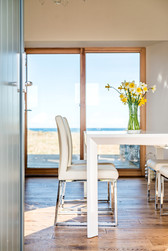 daffodils on table against window view interior photography