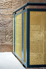 yellow expanded mesh and grey steel balustrade detail interior architectural photography