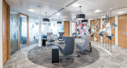 waiting area to offices with modern chairs and sculpture, office photography