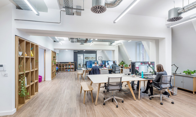 modern offices space with timber flooring and exposed services