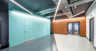 contemporary office lift lobby with exposed brickwork and glazed wall, interior office photography