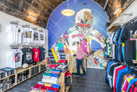 Market-Street-arches-Edinburgh-sports-shop-man-moving-interior-photography