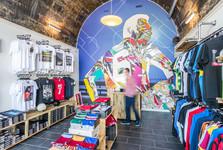 Market-Street-arches-Edinburgh-sports-shop-man-moving-interior-photography