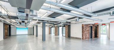 Cat A fitout to refurbished offices with exposed services and internal brick slips, office photography