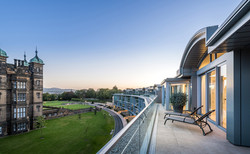 Cala-Homes-penthouse-terrace-sunloungers-dusk-showhome-photographer
