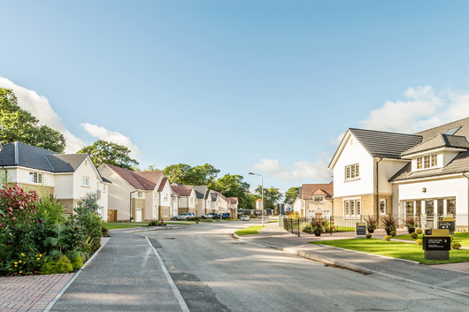 Cala-Homes-sunny-rendered-stone-houses-showhome-street-scene-photography