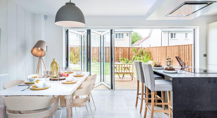 interiors-photography-edinburgh-high-quality-kitchen-dining-room-view-garden-bifold-doors