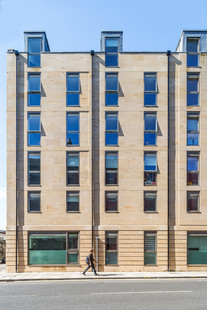 stone clad student residence building exterior education photography