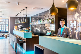 Modern Motel One reception desk and bar interior hotel photography
