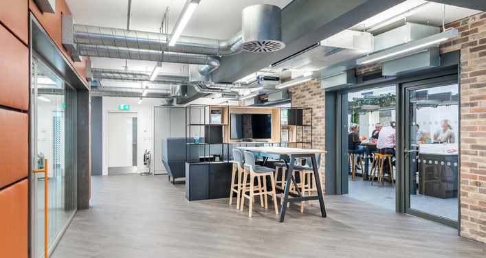contemporary office interior photography showing breakout space, central atrium and exposed brickwork