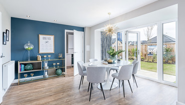 David-Wilson-Homes-dining-table-chairs-patio-doors-timber-floor-dark-blue-wall-showhome-photographer