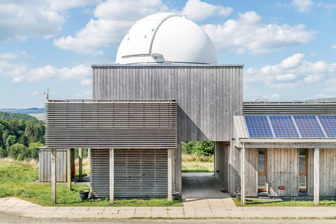 timber clad observatory building with domed roof
